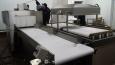 Автоматическая линия вакуумной упаковки мясопродуктов от немецкого производителя BOSS